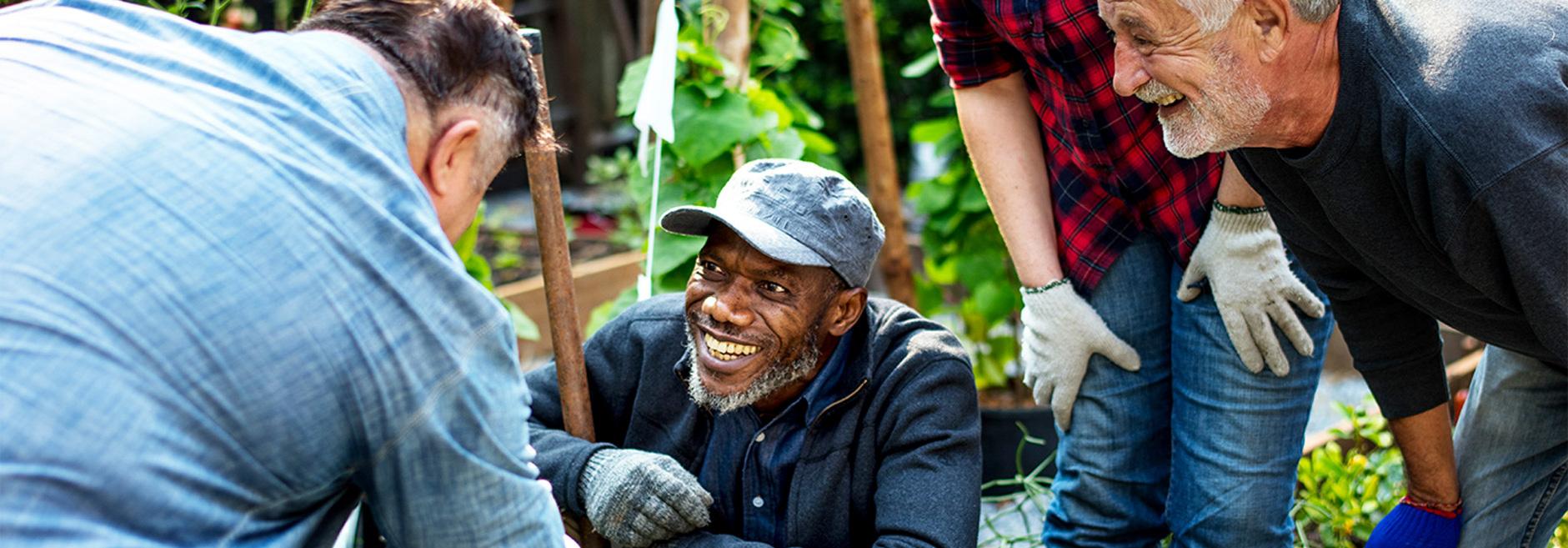men laughing in community garden